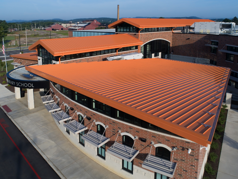 Approximately 18,000 square feet of 22-gauge Tite-Loc Plus panels in a custom finish help emphasize the angled gables topping the new school. Photos: hortonphotoinc.com